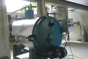 5ème solution : Chaudière vapeur alimentée au bois + alambic